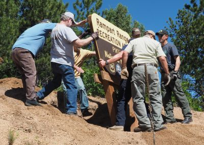 Setting up the new sign at Rampart & 67