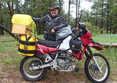 MotoRidePhoto hauling camera equipment on a dirtbike